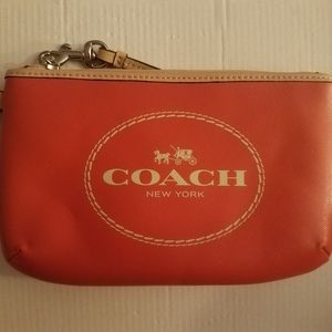 Coach horse and carriage leather medium wristlet